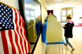 A citizen votes in the primary election Tuesday at St. Mary's Catholic School in Edwardsville.