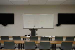 An empty meeting room has a message that roll call will no longer be held at the start of shifts at the Stamford Police Department in Stamford, Conn. Tuesday, March 17, 2020. The Stamford Police are no longer gathering in their meeting room for roll call at the start of their shifts and will just begin solo from their police cruisers.