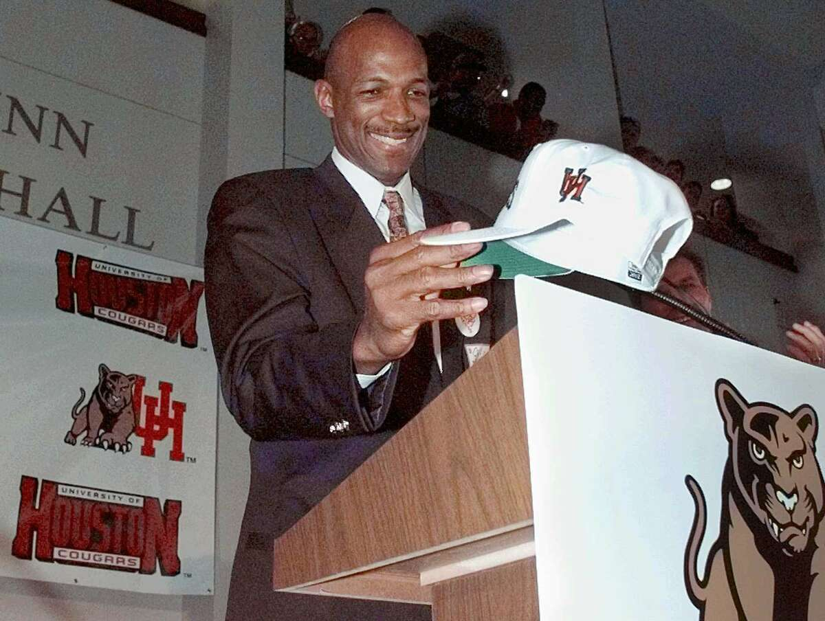 Clyde Drexler places his hat on the podium during a news conference announcing him as the new head coach of the University of Houston men's basketball team March 18, 1998.