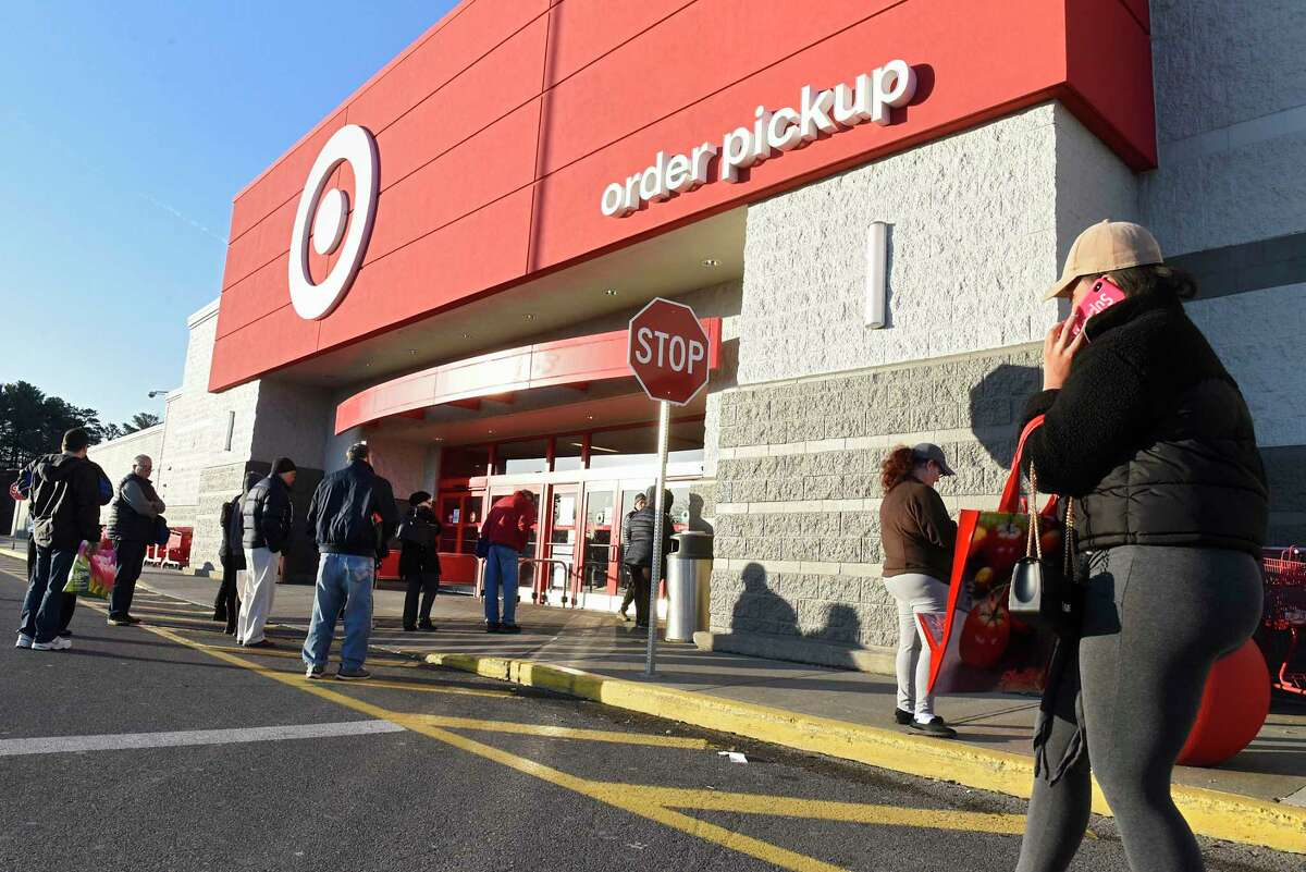 Customers wait outside of Target before they open for the day on Wednesday, March 18, 2020 in Colonie, N.Y. (Lori Van Buren/Times Union)
