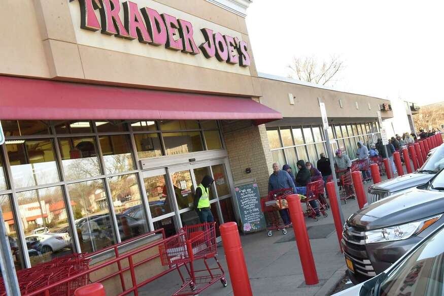 People line up outside of Trader Joe's before they open for the day on Wednesday, March 18, 2020 in Colonie, N.Y. (Lori Van Buren/Times Union)