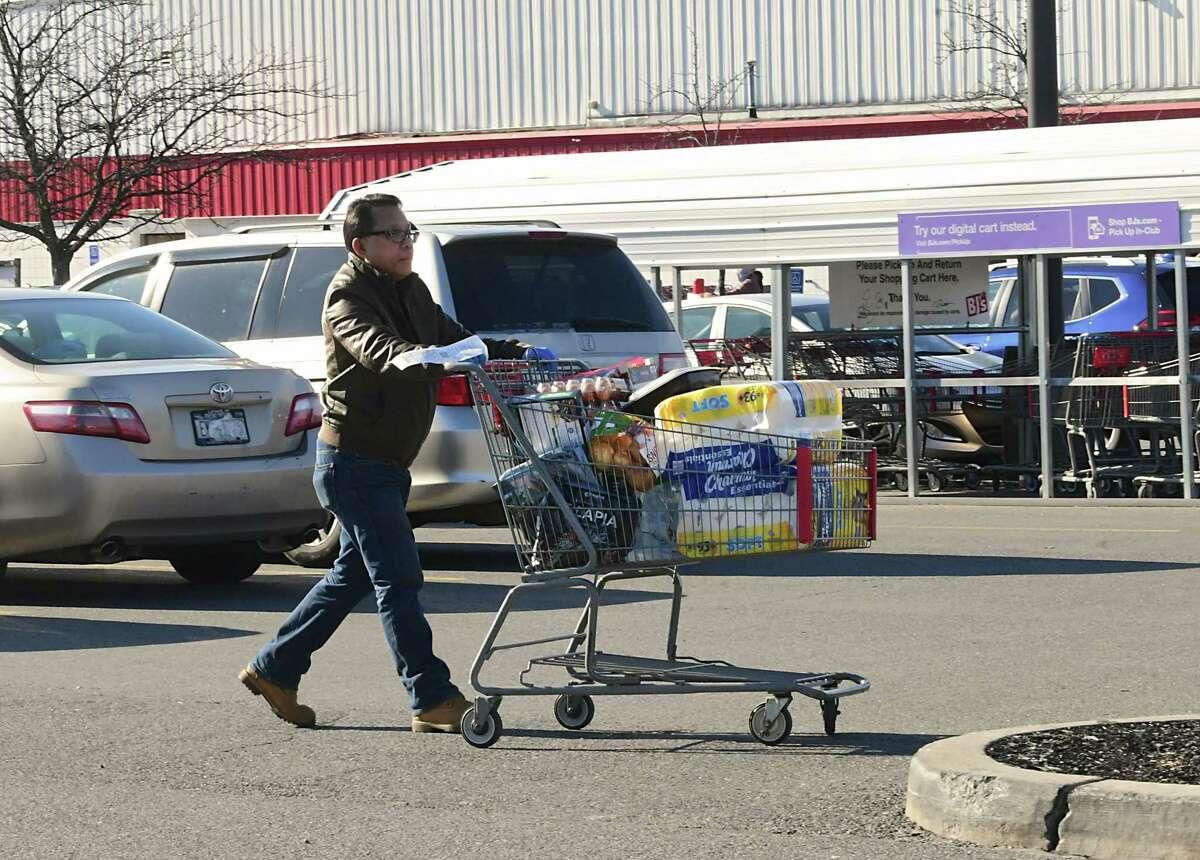 Almost every cart had toilet paper in it as customers leave BJ's Wholesale Club on Wednesday, March 18, 2020 in Colonie, N.Y. (Lori Van Buren/Times Union)