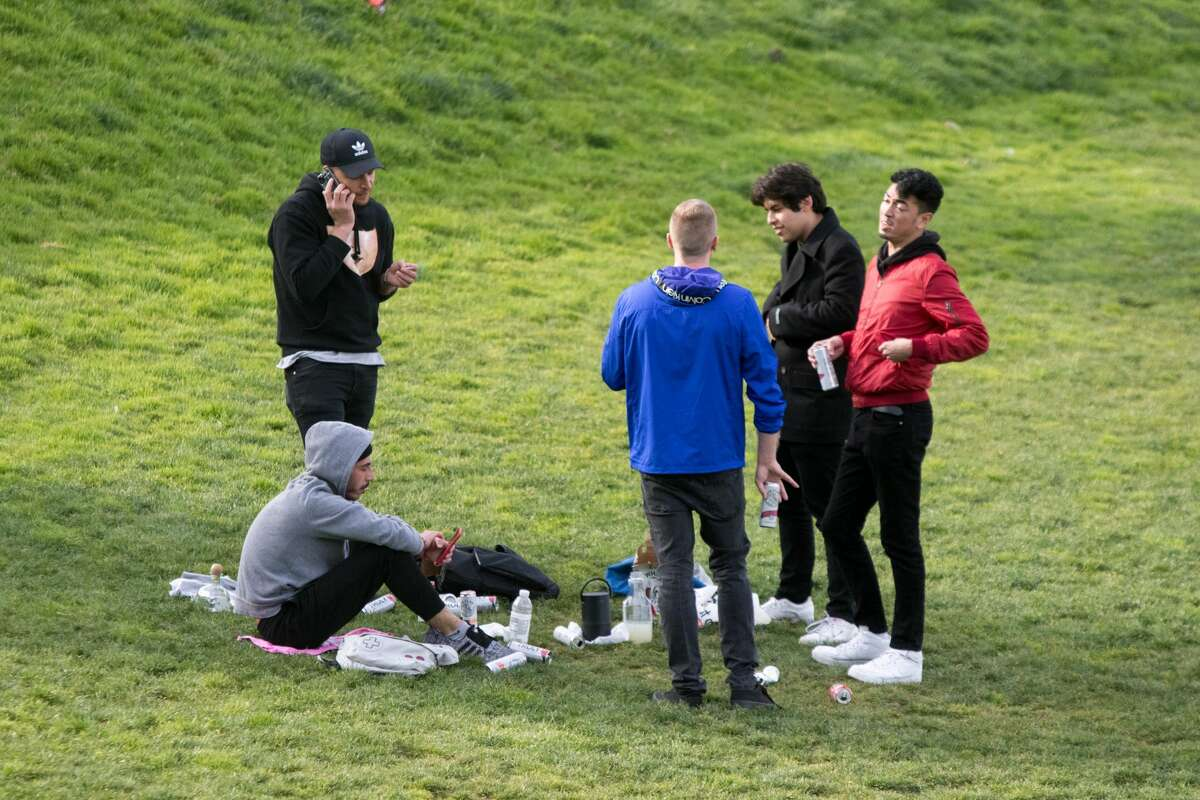 A group of people hang out in Mission Dolores Park. San Francisco had its first shelter-in-place day on March 17th, 2020 in response to the spread of the COVID-19 coronavirus.