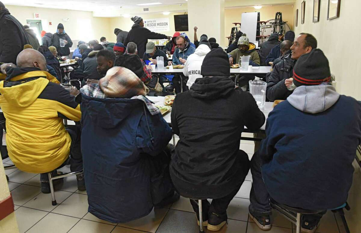 People are seen in the cafeteria eating lunch at the Capital City Rescue Mission on Wednesday, March 18, 2020 in Albany, N.Y. (Lori Van Buren/Times Union)