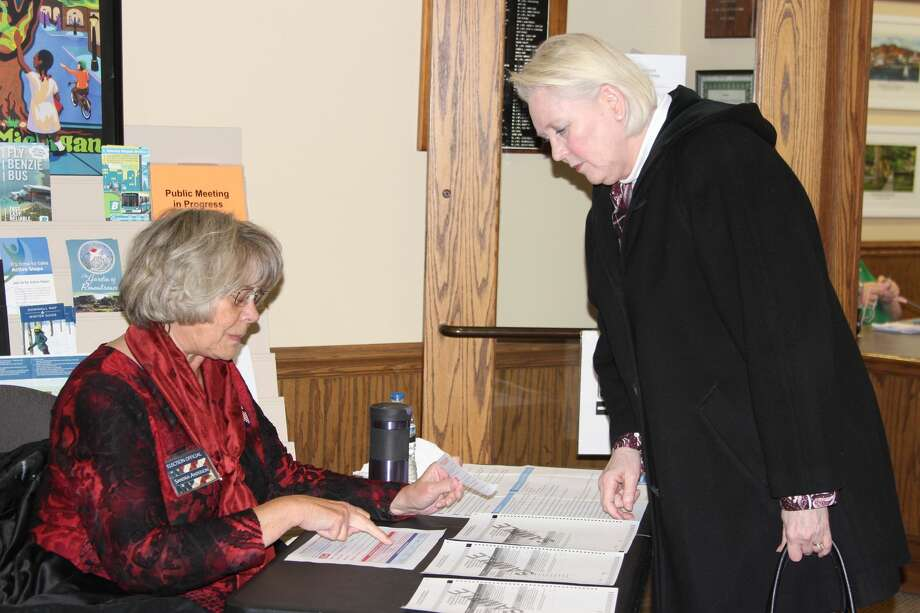 A resident of Frankfort prepares to vote in the March 10 primary, where several county wide millages were approved. (Photo/Colin Merry) Photo: (Photo/Colin Merry)