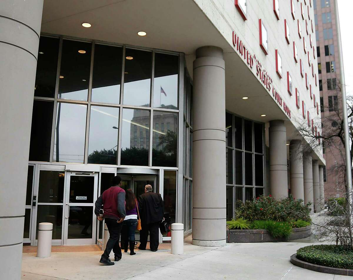 People enter the Bob Casey United States Court House Tuesday, March 10, 2015, in Houston. The federal courts holds a CVB or the civil violations bureau which handles tickets issued on federal property. ( James Nielsen / Houston Chronicle )