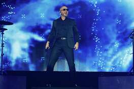 Pitbull's March 27 performance at Foxwoods Resort Casino has been postponed. The rapper is seen here in concert at the H-E-B Center on Feb. 23 in Cedar Park, Texas.