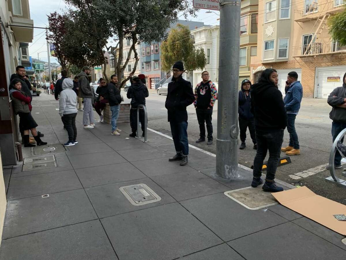 On Tuesday night, a line of more than 100 people wound from the door of Delfina restaurant on 18th Street in San Francisco's Mission District. They were there to collect their last paycheck.