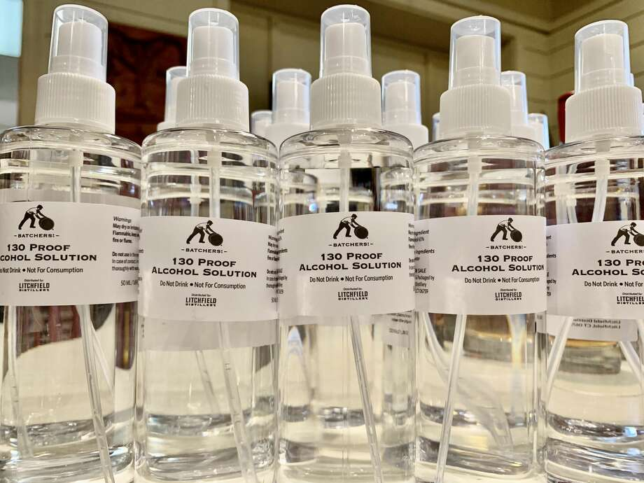 Bottles of alcohol spray at Litchfield Distilleries in Litchfield, Conn. Photo: Litchfield Distillery