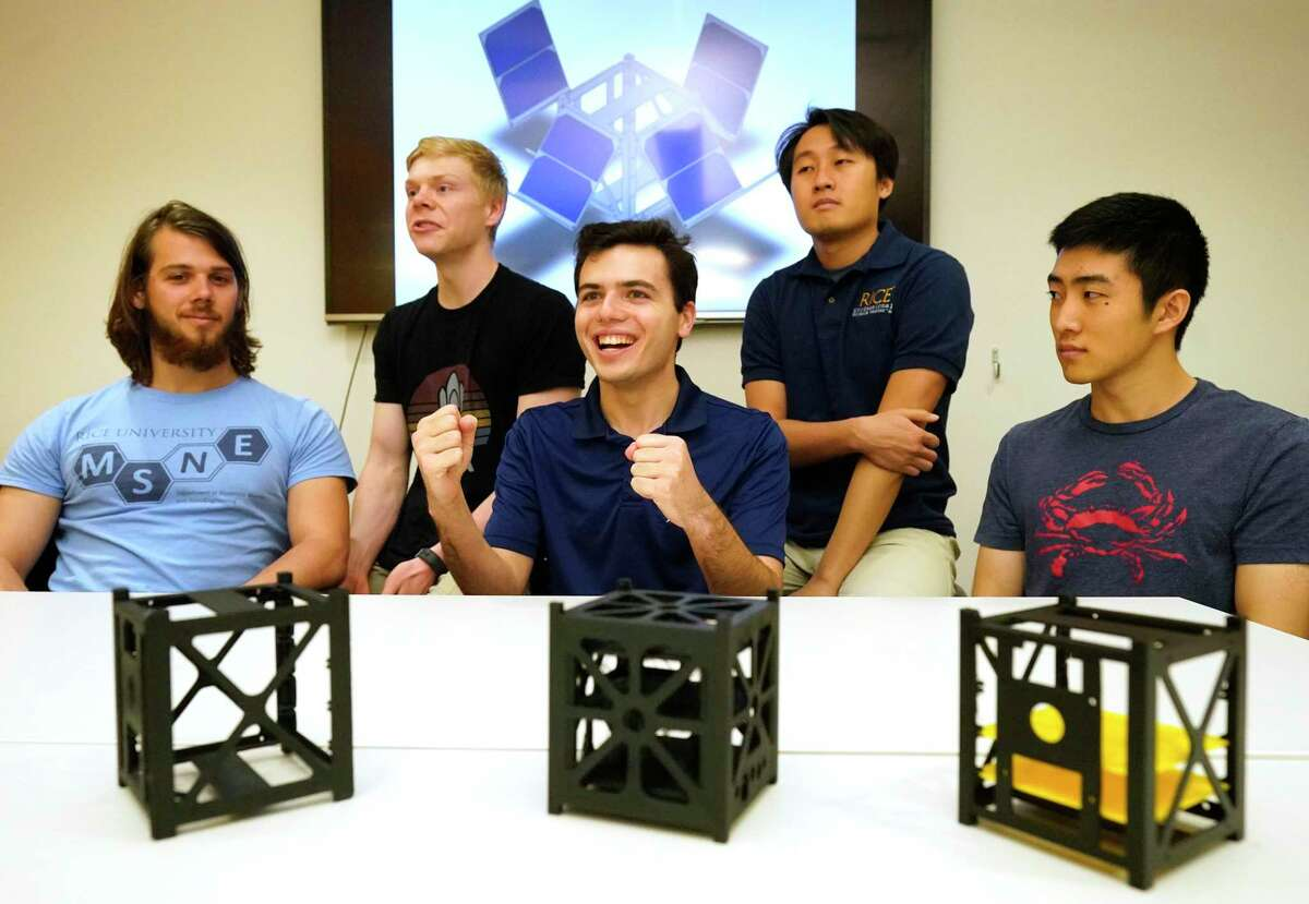 Rice University students Doug Steinbach, left, Paul Glenski, Ryan Udell, Hoik Jang, and Eric Yang, right, show mock-ups reflecting the size of their research cube satellite (CubeSat) on Wednesday, March 4, 2020, in Houston. The OwlSat CubeSat will collect data over the course of one year to see how extreme ultraviolet radiation can alter a satellite's path in low-Earth orbit, the area where the International Space Station resides.