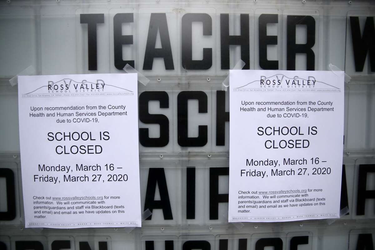 A message board outside of Brookside Elementary school is covered over with signs announcing the school is closed on March 17, 2020 in San Anselmo, California. Six Bay Area counties have decided to extend school closures to May 1.