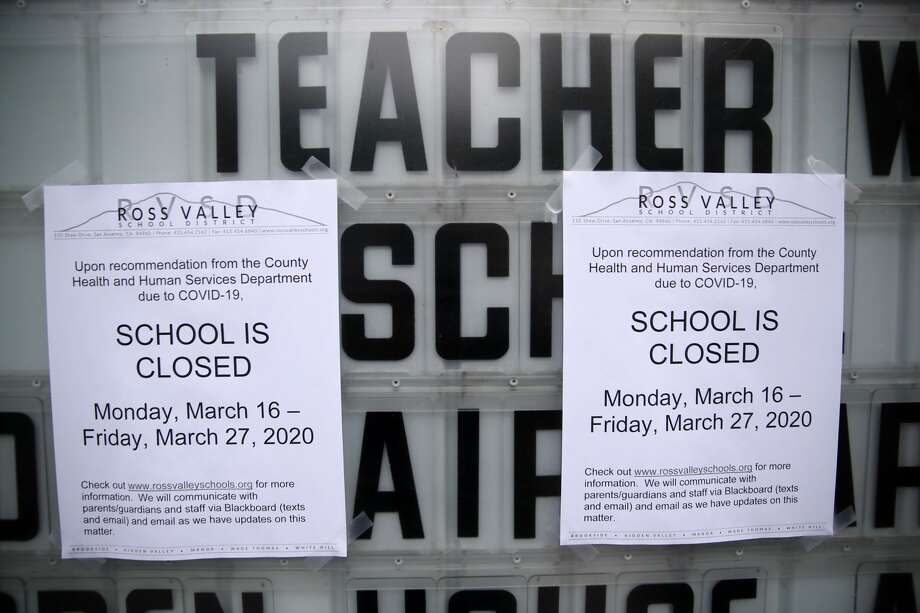 A message board outside of Brookside Elementary school is covered over with signs announcing the school is closed on March 17, 2020 in San Anselmo, California. Six Bay Area counties have decided to extend school closures to May 1. Photo: Justin Sullivan/Getty Images