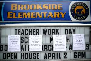 A message board outside of Brookside Elementary school is covered over with signs announcing the school is closed on March 17, 2020 in San Anselmo, California. Restaurants are only allowed to offer food to go as seven San Francisco Bay Area counties have ordered residents to shelter in place in an effort to reduce social interaction and slow the spread of the coronavirus. (Photo by Justin Sullivan/Getty Images)