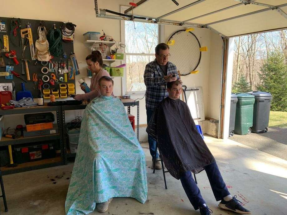 Patrick Burke and Brady Kuczo get their heads shaved by Sharon and Jim Burke. Photo: Contributed Photo / / Wilton Bulletin Contributed