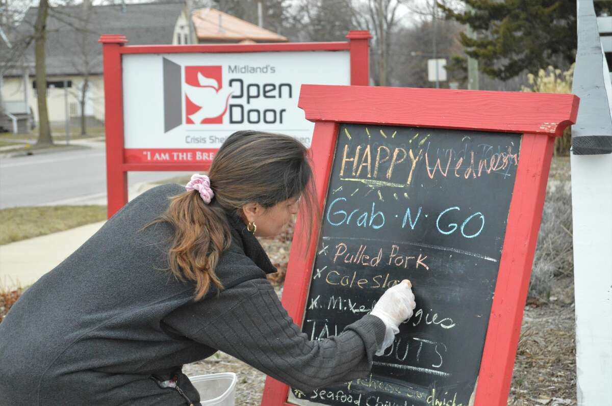 Midland's Open Door, located at 412 W. Buttles St., has transitioned to serving meals to the public in a to-go fashion amid the coronavirus pandemic. People who stop by are asked to pick up their meals on the front porch, where they can get a packed lunch, a soup, a packaged hot meal, salad, fruit, coffee, dessert, and more. Volunteers still work inside to make it all happen. (Ashley Schafer/Ashley.Schafer@hearstnp.com)