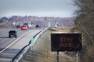 An electronic sign on the side of Interstate 90 westbound shows the message stay home on Wednesday, March 18, 2020, in East Greenbush, N.Y.    (Paul Buckowski/Times Union)