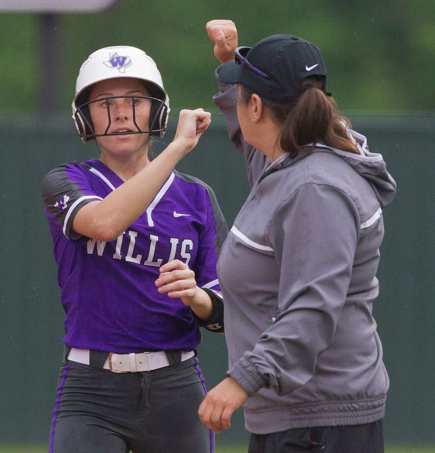 Hannah Earls #6 of Willis gets a fist-bump after hitting a single during the first inning in Game 1 of a Region III-5A bi-district softball playoff match, Wednesday, April 24, 2019, in Willis. Photo: Jason Fochtman, Houston Chronicle / Staff Photographer / © 2019 Houston Chronicle