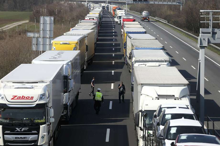 Lines of trucks wait to cross the border between Austria and Hungary, which has been opened in phases. Photo: Ronald Zak / Associated Press