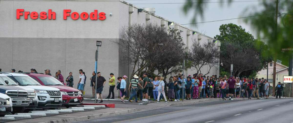 Shoppers line up at an H-E-B in Laredo a day after a case of COVID-19 was confirmed there. A disappointed reader scolds Texans for hoarding during the pandemic.