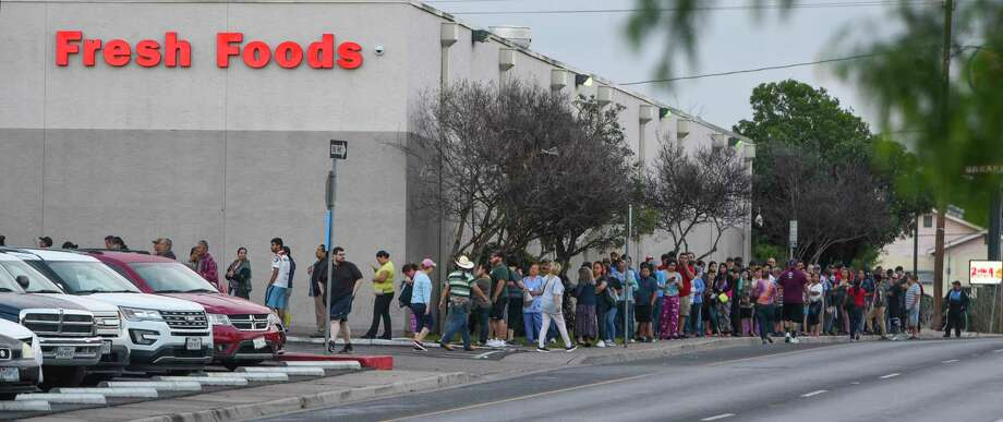 Shoppers line up at an H-E-B in Laredo a day after a case of COVID-19 was confirmed there. A disappointed reader scolds Texans for hoarding during the pandemic. Photo: Danny Zaragoza /Laredo Morning Times
