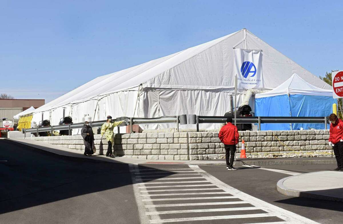 Valet parking attendants, right, direct traffic outside the coronavirus testing tent in the rear parking lot at Albany Medical Center on Wednesday, March 18, 2020 in Albany, N.Y. (Lori Van Buren/Times Union)