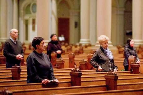 A small group of church attendees gather for mass in San Francisco, Calif. Many people have turned to online forms of worship. During a national emergency, it's just as important to care for your soul as it is to wash your hands. Pray. Meditate. Listen to music. Watch a movie. Breathe.
