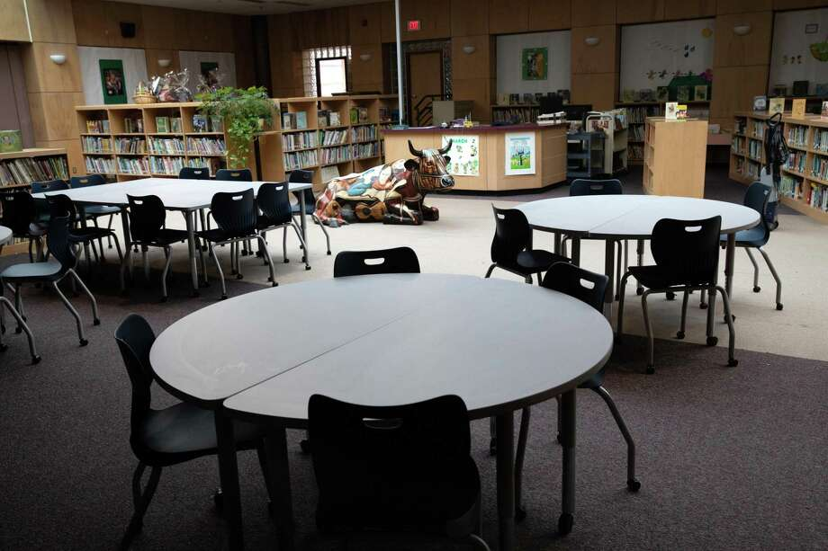 A library sits empty at the KT Murphy Elementary School in Stamford on March 17. Stamford Public Schools closed last week to help slow the spread of the novel coronavirus. Photo: John Moore / Getty Images / 2020 Getty Images