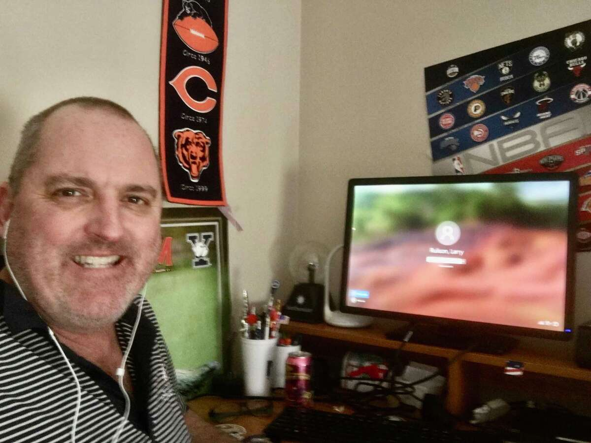 Times Union reporter Larry Rulison at his home office, which he made in his 10-year-old son's room that he had taken over during chemo treatments to combat his appendix cancer.
