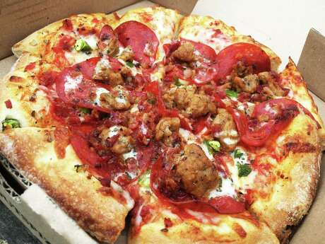 The William Chris pizza at Stout's Pizza Co. has pepperoni, Italian sausage, bacon, chopped jalapenos, garlic and a light drizzle of ranch dressing.