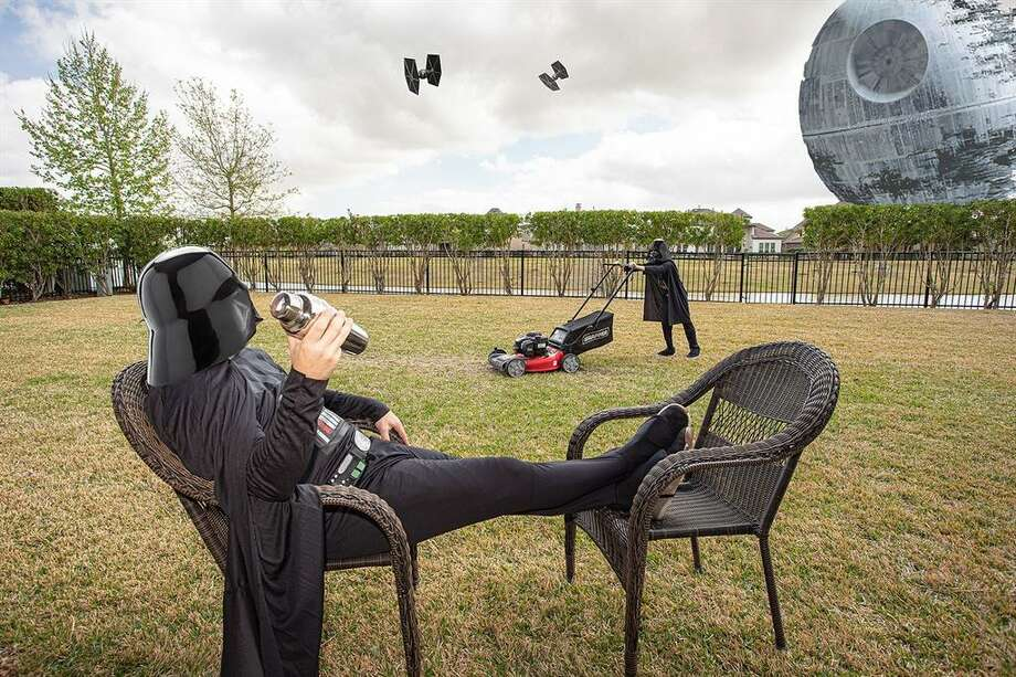 "Houston realtor Ellis Young and his children, Bryce, 13, and Kaiden, 9, donned their best ""Star Wars"" gear and channeled the dark side to help attract attention to this Friendswood home, which was just listed at nearly $1 million. Photo: Houston Association Of Realtors"
