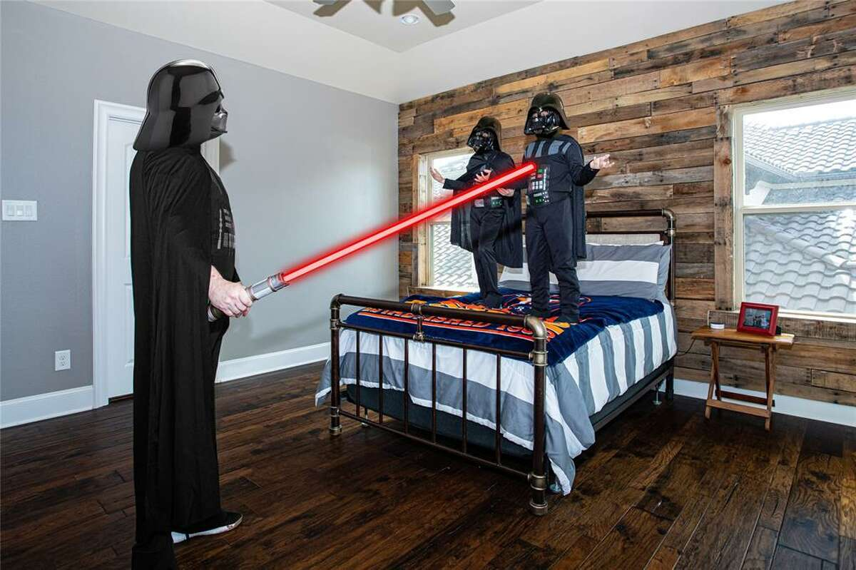 """Houston realtor Ellis Young and his children, Bryce, 13, and Kaiden, 9, donned their best """"Star Wars"""" gear and channeled the dark side to help attract attention to this Friendswood home, which was just listed at nearly $1 million."""