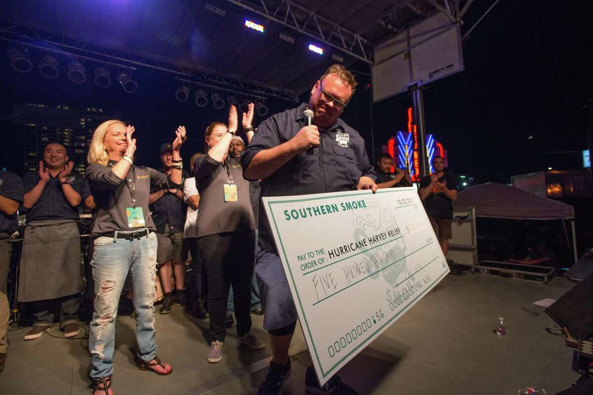 Chris Shepherd holds a $500,000 check for Hurricane Harvey relief at Southern Smoke 2017.