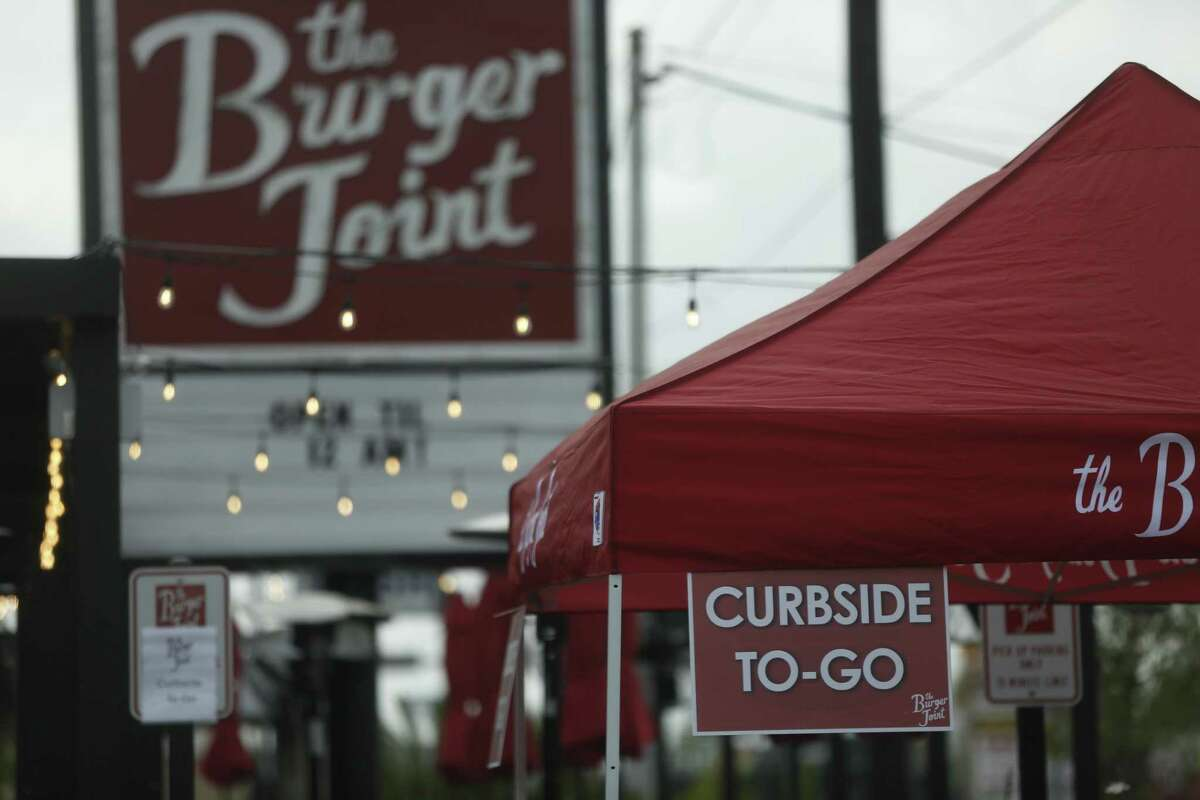 Burger Joint in the Heights neighborhood in Houston set up a curbside to-go tent to help keep pedestrian traffic flowingon Tuesday, March 17, 2020.