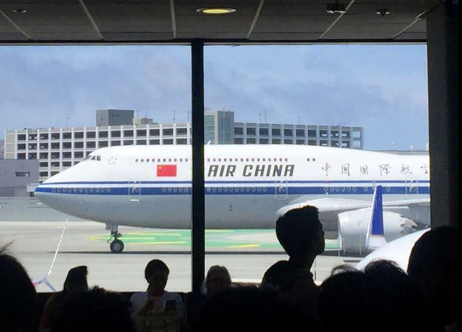 An Air China 747 lumbers through SFO. The Chinese national carrier's flights between the US and China are on hold as tensions rise between the US and China Photo: Chris McGinnis