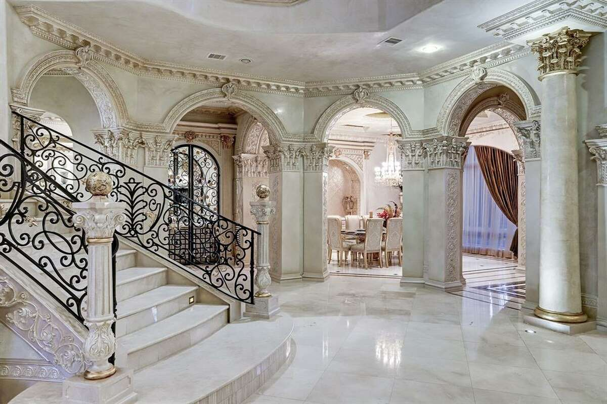 The resort-like home at 5324 Palm Royale Boulevard is listed at $9.9 million.