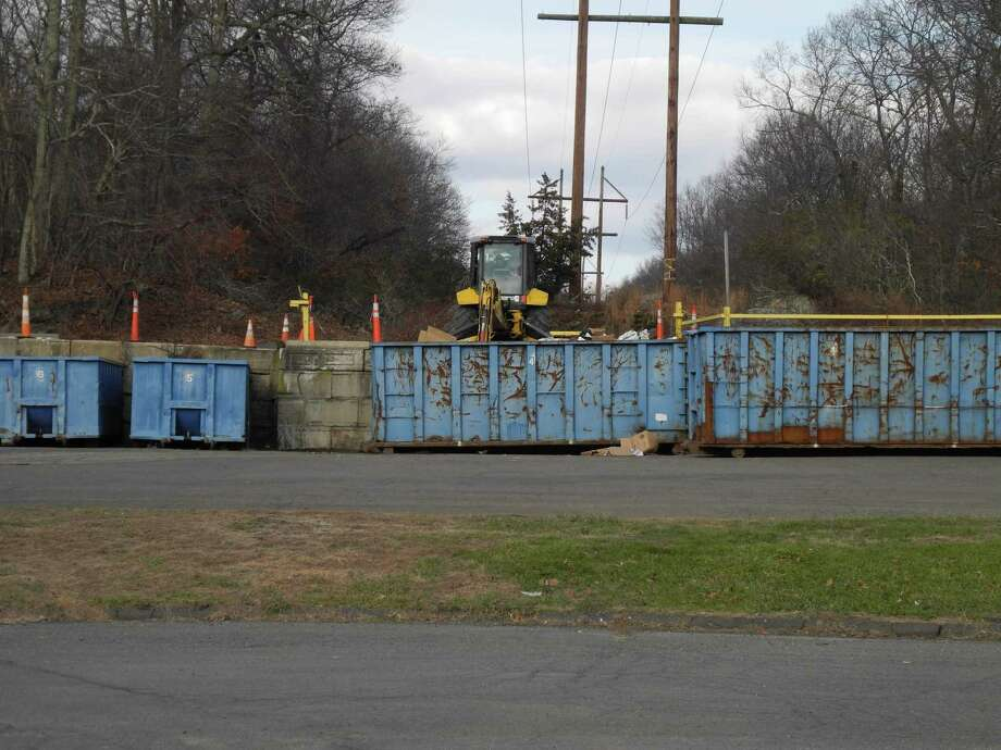 Wilton residents may deposit their recyclables in the containers at the transfer station. Due to concerns about the spread of COVID-19, the station is operating under new hours and with certain restrictions. Photo: Jeannette Ross / Hearst Connecticut Media / Wilton Bulletin