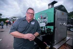 Southern Smoke founder Chris Shepherd and the Southern Smoke smoker, made by Pitmaker, which was raffled off to raise money.