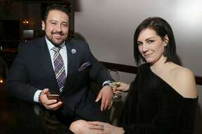 Albany, NY - March 14, 2020 - (Photo by Joe Putrock/Special to the Times Union) - On an uncharacteristically slow St. Patrick's Day night, Restaurateur Dominick Purnomo, left, sits at the bar of his restaurant DP An American Brasserie with his wife Carolyn discussing ways to bring chefs, suppliers, farms, restaurants and volunteers together in order on help food insecure children through the unexpected school closings all of over the Capital District.