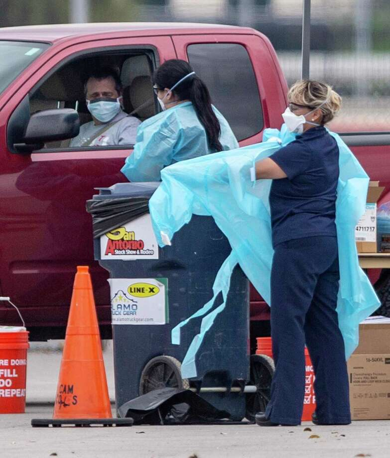 As more people are tested for coronavirus in Bexar County, including at this drive-up test site, more cases are emerging. A woman in her 80s was the first person in Bexar County to die from a coronavirus infection. She died on Saturday, March 21, 2020, while in hospice care. Photo: William Luther /Staff Photographer / ©2020 San Antonio Express-News