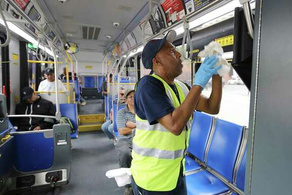 A man wipes down a VIA bus last month to keep it clean during the pandemic. VIA has taken another steps to safely maintain operations during this time. A reader suggests requiring all riders to wear masks.
