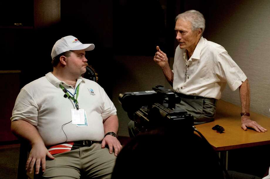 "In this image released by Warner Bros. Pictures, director Clint Eastwood speaks with actor Paul Walter Hauser as they work during the filming of the movie ""Richard Jewell."" When a bomb exploded in a downtown Atlanta park midway through the 1996 Olympics, it set news reporters and law enforcement on a collision course that upended the life of a security guard, turning him from hero to villain overnight. Now, more than 20 years later, a recent book and upcoming movie explore Jewell's ordeal and the roles played by law enforcement and the media. Photo: Claire Folger, HONS / Associated Press / Warner Bros. Pictures"