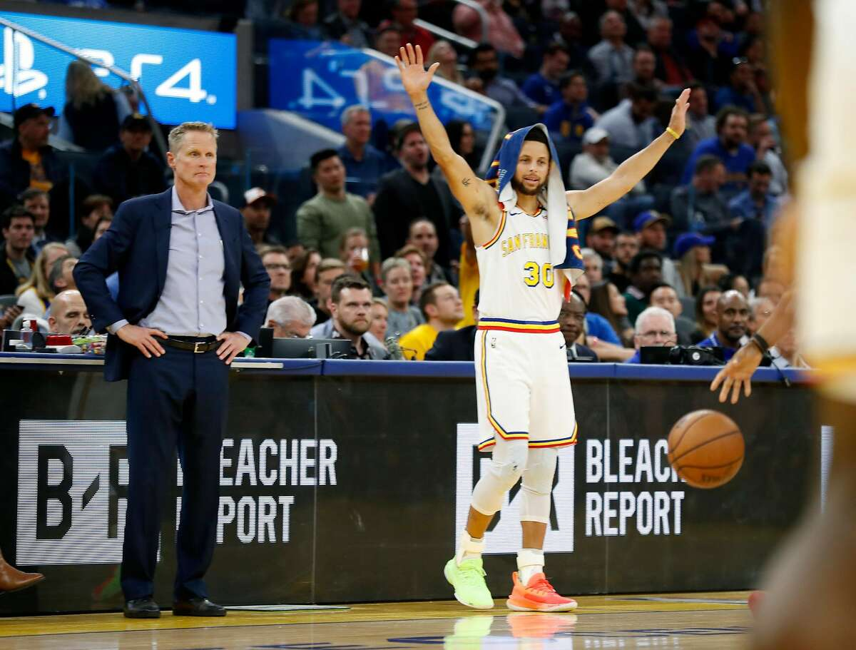 Golden State Warriors' Stephen Curry and head coach Steve Kerr during Toronto Raptors' 121-113 win in NBA game at Chase Center in San Francisco, Calif., on Thursday, March 5, 2020.