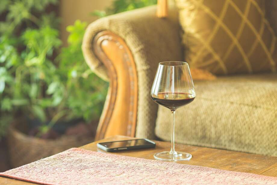Wine consumption has moved from bars, restaurants and tasting rooms to the nation's couches. Photo: Jennifer McCallum / Getty Images/iStockphoto