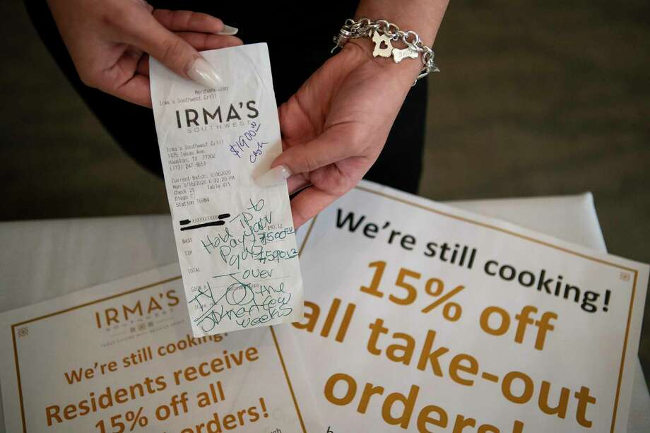 An anonymous couple left a tip totaling thousands of dollars for staff at Irma's Southwest earlier this week in response to the restaurant's coronavirus-related slowdown, Wednesday, March 18, 2020, in downtown Houston. Photo: Mark Mulligan, Houston Chronicle / Staff Photographer / © 2020 Mark Mulligan / Houston Chronicle