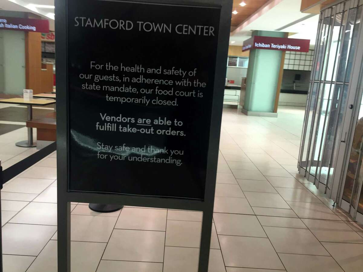 A signed posted in the Stamford Town Center food court on Tuesday, March 17, 2020.