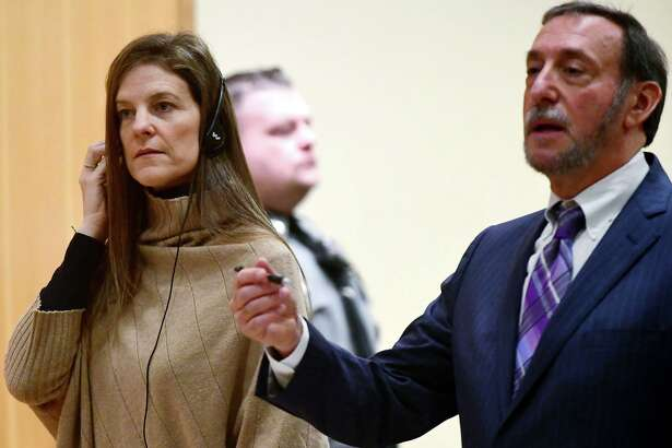 Michelle Troconis, charged with conspiracy to commit murder in the disappearance of Jennifer Dulos, appears for a pre-trial hearing with an spanish interpreter and her attorney Jon L. Schoenhorn Friday, February 6, 2020, at the Stamford Superior Court in Stamford, Conn.
