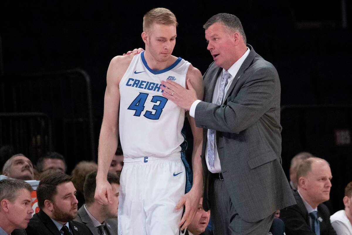 Creighton head coach Greg McDermott talks to center Kelvin Jones (43) during the first half of an NCAA college basketball game against the St. John's in the quarterfinals of the Big East men's tournament, Thursday, March 12, 2020, at Madison Square Garden in New York. The Big East announced at halftime that the tournament was cancelled due to coronavirus concerns. (AP Photo/Mary Altaffer)
