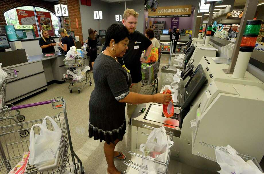 Annmarie Lobban is assisted by an employee as she uses a self check out station to make her purchases at a newly renovated Stop and Shop market in Greenwich, Connecticut on August 25, 2017. Photo: Matthew Brown / Hearst Connecticut Media / Stamford Advocate