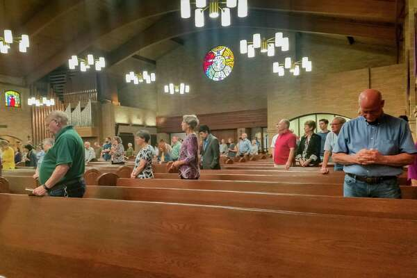 The early morning Mass at St. Jude Thaddeus Catholic Church had a lot of empty pews on March 15, 2020 due to the coronavirus situation. Bishop Curtis Guillory excused diocesan Catholics most susceptible to the virus from attendance at weekly Mass during the pandemic. Fran Ruchalski/The Enterprise
