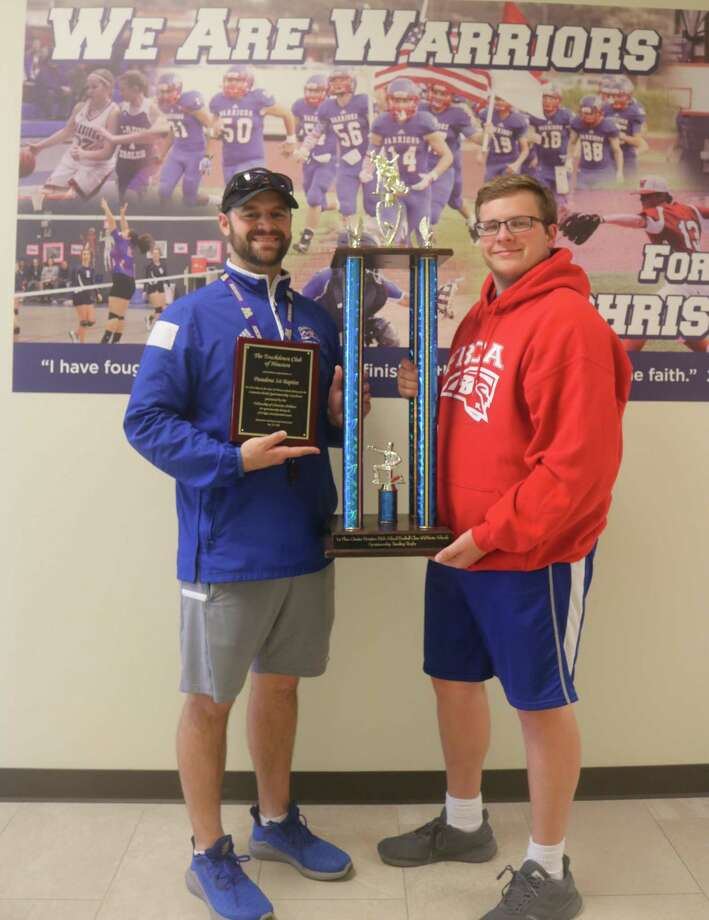 Pasadena-FBCA head football coach Justin Larsen (left) and player Chris Brown display the Houston Touchdown Club's large traveling Sportsmanship Award trophy and the permanent plaque the school will keep. Photo: Robert Avery